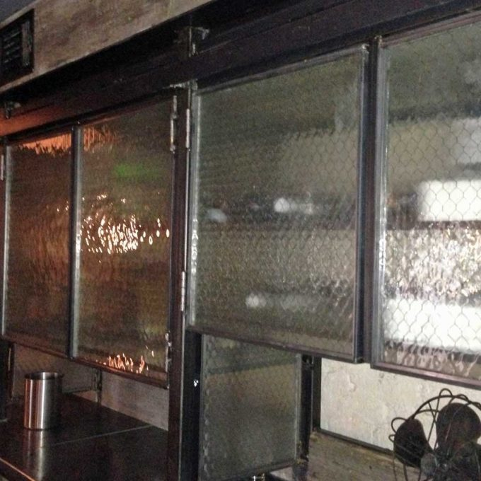 Alqua Restaurant hammered chicken wire glass