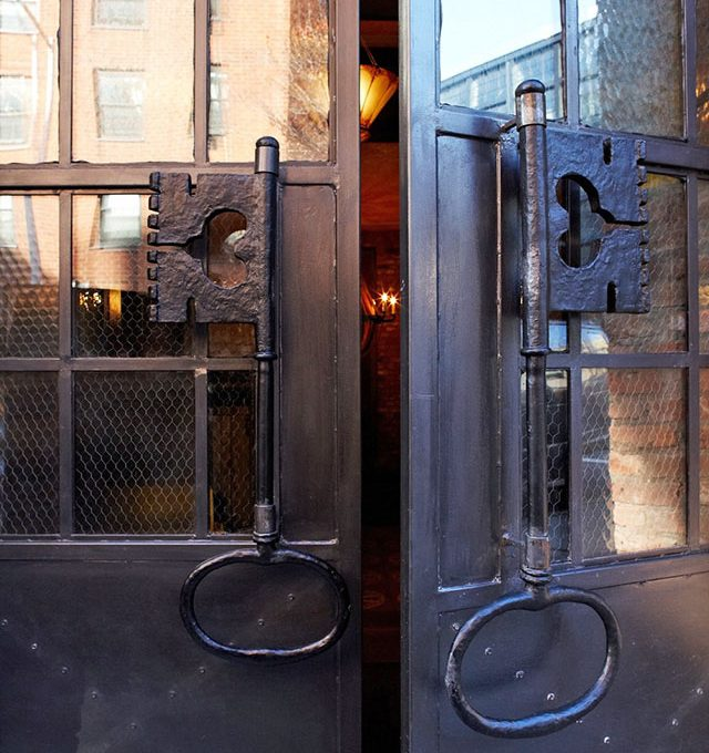 Cata Restaurant chicken wire glass doors