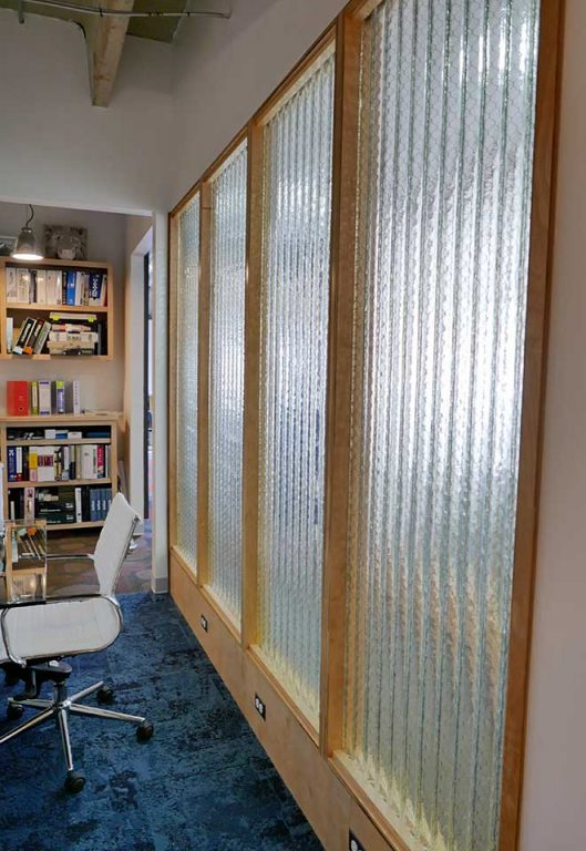 Clear corrugated glass conference room wall
