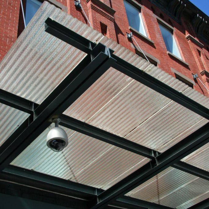 NYC apparel showroom clear corrugated chicken wire glass canopy