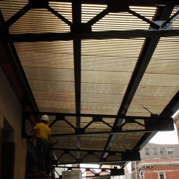 West Village NYC amber corrugated chicken wire glass canopy